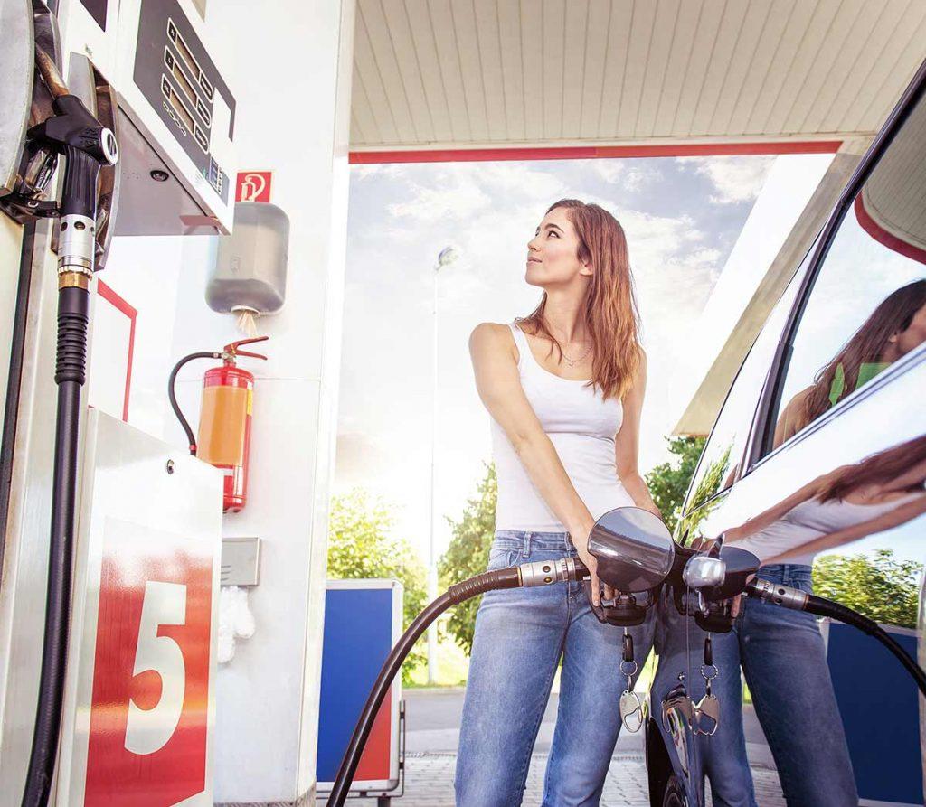 woman at petrol pump